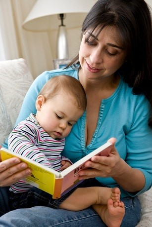 Mom reads to infant